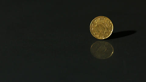 Euro coin spinning on black surface Footage