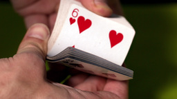 Hand flicking through deck of cards Stock Video Footage