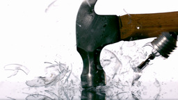 Hammer smashing light bulb on white background Stock Video Footage
