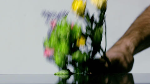 Hand smashing bouquet of flowers Stock Video Footage
