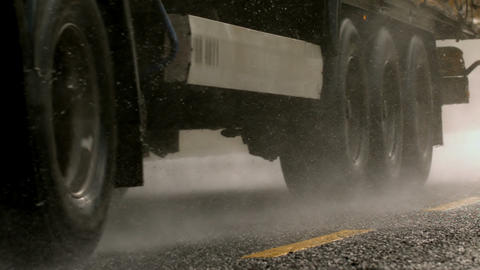 Heavy lorry driving over wet road Footage