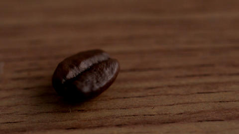Coffee beans spinning on wooden surface Stock Video Footage