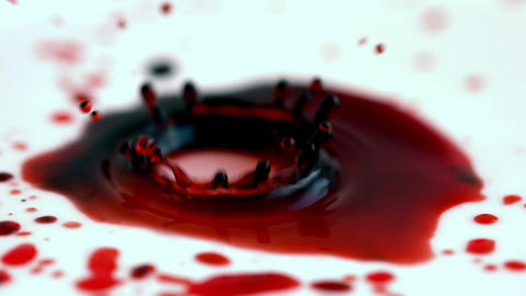 Blood dropping onto white surface Stock Video Footage