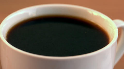 Sugar cube falling into cup of coffee Stock Video Footage