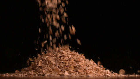 Cereal flakes pouring on black background Stock Video Footage