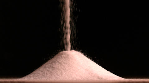 Sugar pouring on black background Stock Video Footage