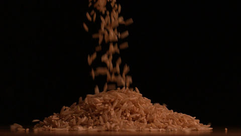 Rice pouring on black background Footage