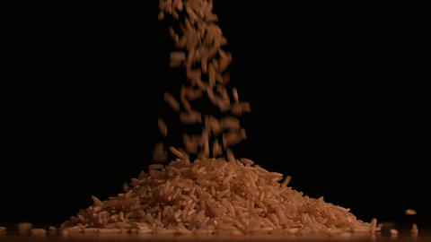Rice pouring on black background Stock Video Footage