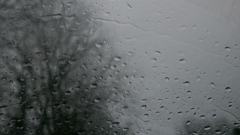 Rain falling onto car windshield Footage
