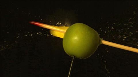 Arrow shooting through green apple on black background Stock Video Footage