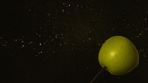 Arrow shooting through green apple on black background Footage