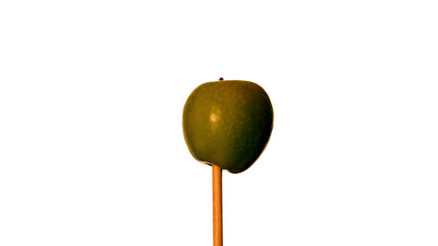 Arrow shooting through green apple on white background Stock Video Footage