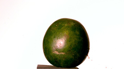 Arrow shooting through watermelon on white background Stock Video Footage