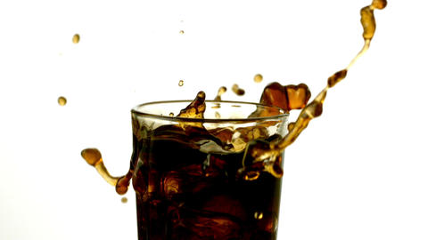 Ice cubes falling into glass of soda Footage