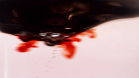 Blood swirling in water on white background Stock Video Footage