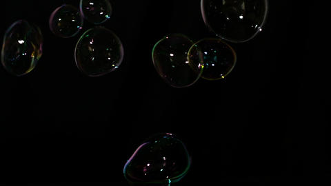 Bubbles floating on black background Stock Video Footage
