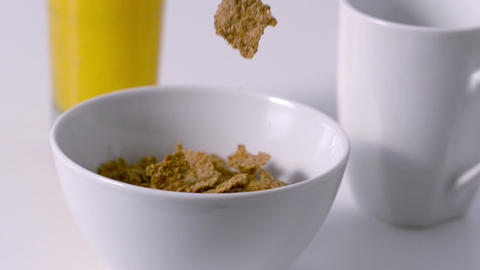 Cereal pouring into a bowl at breakfast table Stock Video Footage