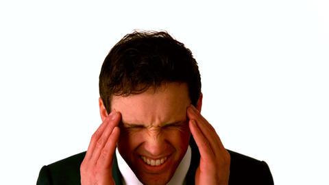 Businessman with a headache rubbing his head Footage