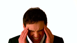 Businessman with a headache rubbing his head Stock Video Footage