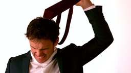 Angry businessman taking off his tie and throwing it Stock Video Footage
