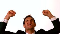 Businessman cheering on white background Footage