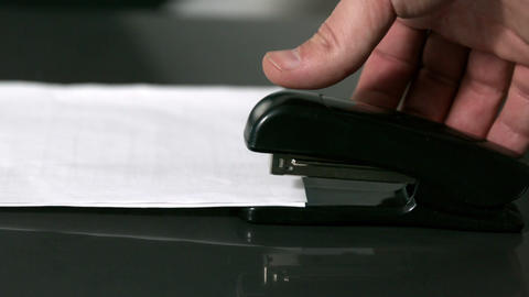 Hand pushing down on stapler Stock Video Footage