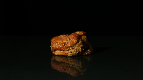 Scone falling on black background Live Action