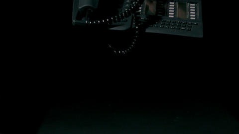 Telephone falling on black background Stock Video Footage