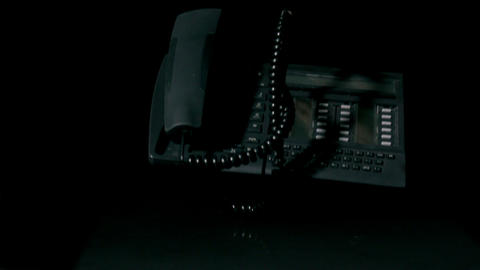 Telephone falling on black background Live Action