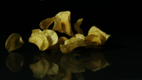 Chips falling on black surface Footage