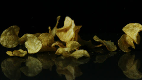 Chips falling on black surface Stock Video Footage