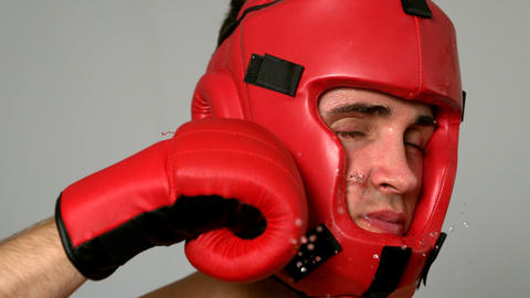Tough boxer taking a punch to the face Footage