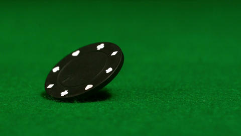 Black chip spinning on casino table Live Action