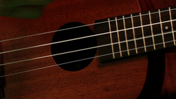 Hand strumming guitar strings close up Footage