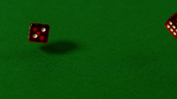 Red dice rolling on casino table Footage