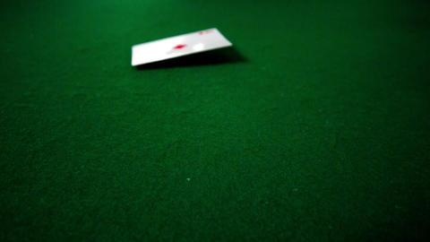 Ace of diamonds falling towards camera Footage