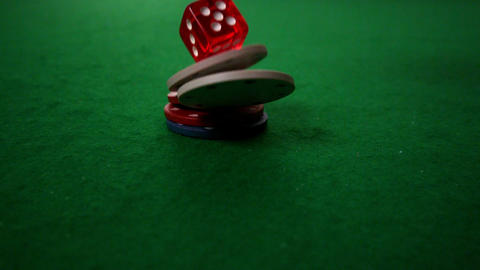 Red dice and chips falling on casino table Footage