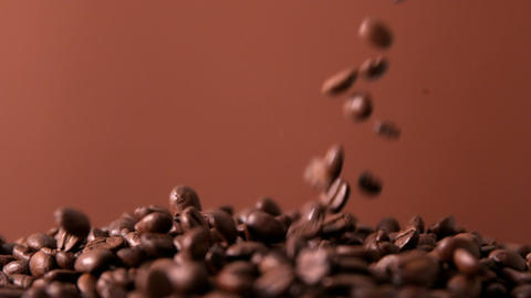 Coffee beans pouring onto pile Footage