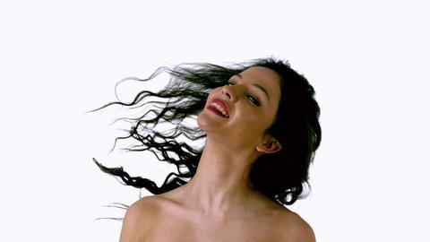 Beautiful brunette shaking her hair Footage