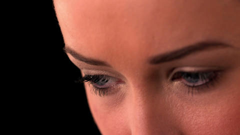 Close up of womans eyes on black background Footage