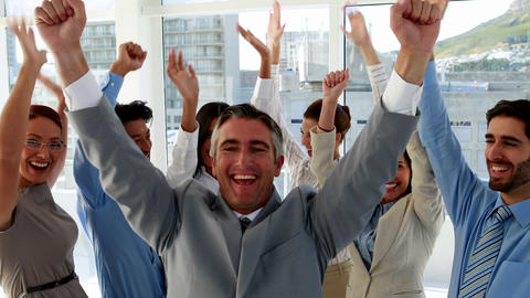 Excited business team cheering at camera Footage