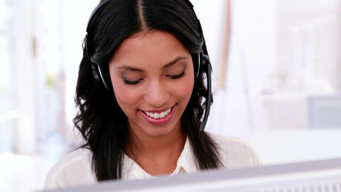 Call centre agent working and talking on headset Footage
