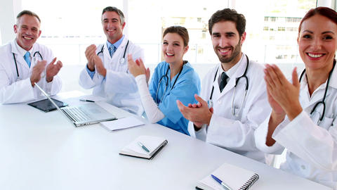 Medical team clapping during a meeting Footage