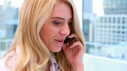 Pretty blonde businesswoman smiling at camera talking on phone Footage