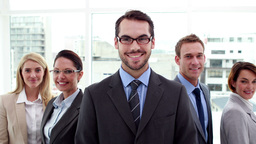 Smiling business team posing for camera Footage