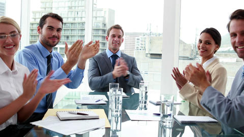 Business people clapping at camera in board room Footage