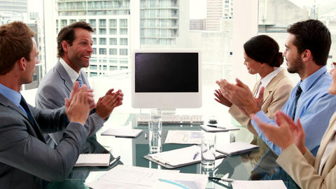 Business team clapping a blank screen Footage