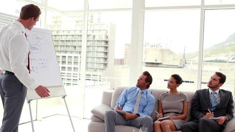 Business team listening to presentation 影片素材