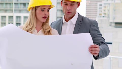 Two architects anaylzing plans together Footage