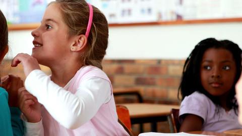Little girls telling secrets in the classroom Footage
